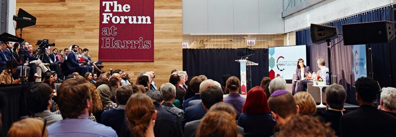 Dean Katherine Baicker speaking at event in Harris Keller Forum